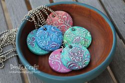 Clay painted pendants in wood bowl (2)