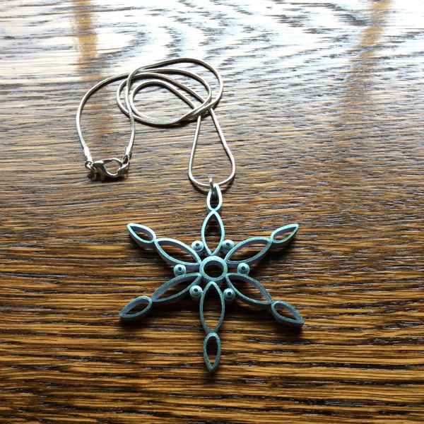 Make a modern quilled snowflake necklace